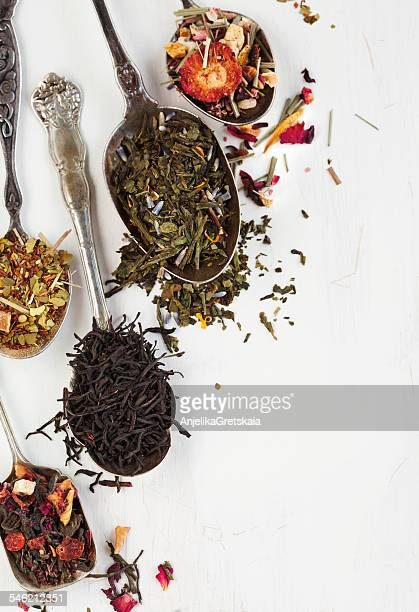 different types of tea leaves in spoons - tea leaves stock photos and pictures