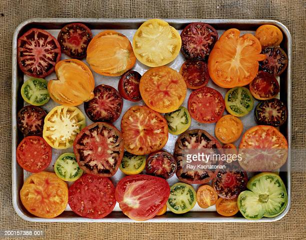Different varieties of tomatoes on tray