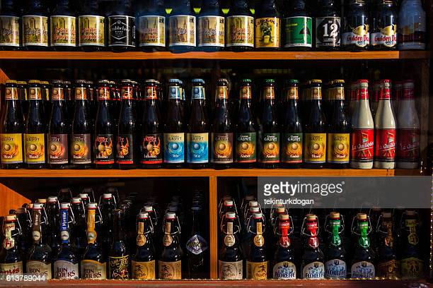 different variety of belgian beers  on store at ghent belgium - belgian culture stock pictures, royalty-free photos & images