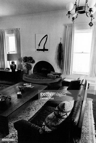A different way to show off the crackling fire is this circular hearth extending into living room of Stan Bonds' house Credit Denver Post Inc