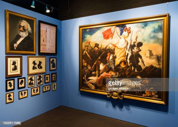 Different works are displayed in front of a blue wall at the special exhibition 'DUCKOMENTA' in the Archäologisches Museum Hamburg Germany 07 June...