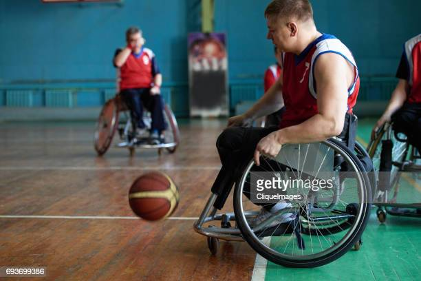 differently abled basketball players on court - cliqueimages stock pictures, royalty-free photos & images