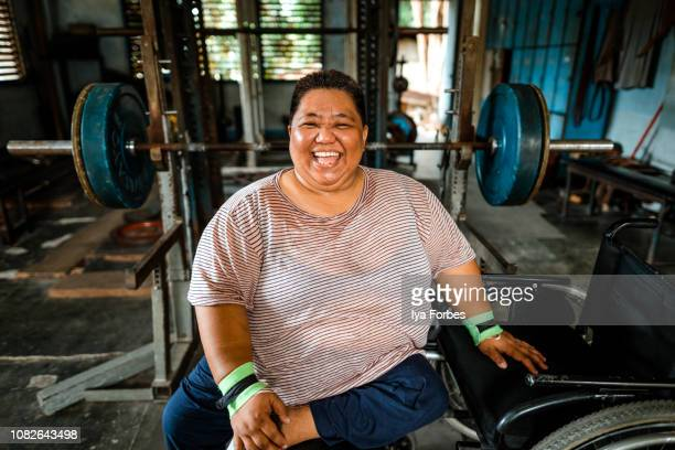 Differently abled Filipino powerlifter smiling