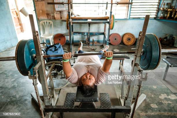 Differently abled Filipino powerlifter training