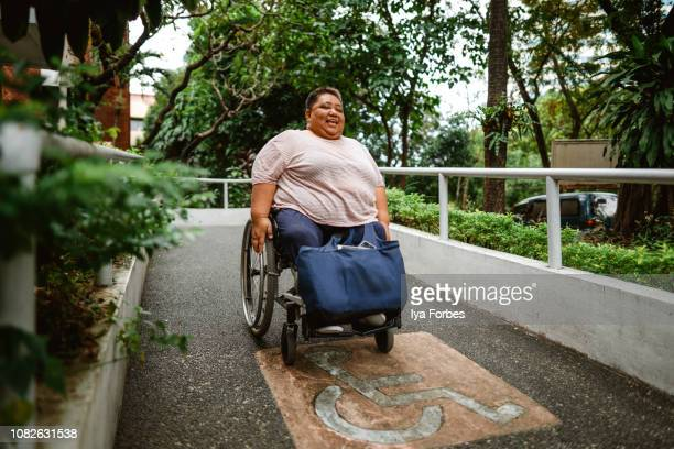 Differently abled Filipino woman going down slope