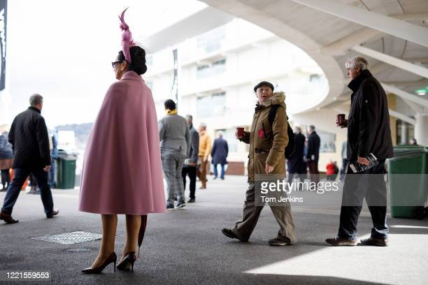 Differing outfits during Ladies Day during day two of the Cheltenham National Hunt Racing Festival at Cheltenham Racecourse on March 11th 2020 in...