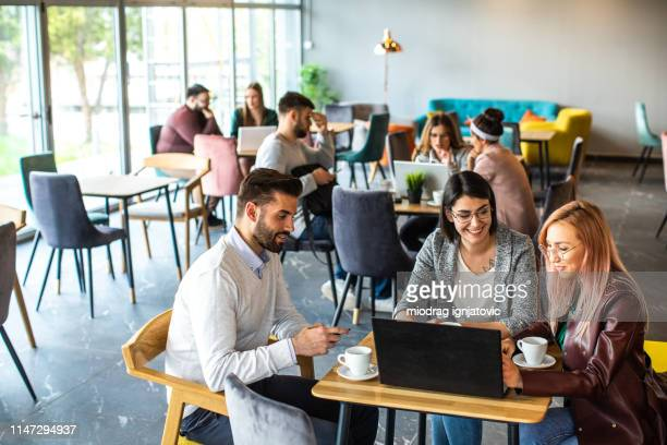 difficult becomes easy when you have a great team - internet cafe stock pictures, royalty-free photos & images