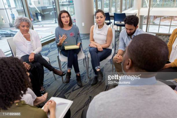 a difficult moment during a breakout session - small group of people stock pictures, royalty-free photos & images