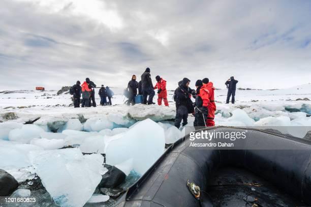 Difficult ship boarding procedure due to ice at Chilean Base President Eduardo Frei Montalva on November 04 2019 in King George Island Antarctica