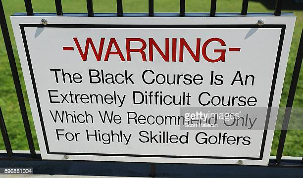 A difficulty sign is seen behind the first tee during the final round of The Barclays in the PGA Tour FedExCup PlayOffs on the Black Course at...