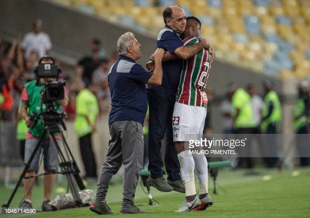 Digao of Brazil's Fluminense celebrates with the team's head coach Marcelo Oliveira after scoring a goal against Ecuador's Deportivo Cuenca during...