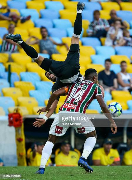 Digao of Fluminense struggles for the ball with Yago Pikachu of Vasco da Gama during a match between Fluminense and Vasco da Gama as part of...
