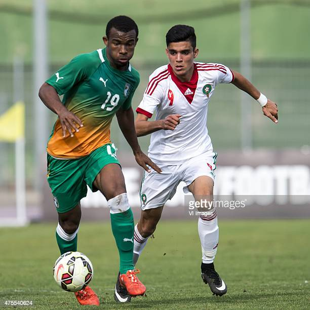 Digbo Habib Maiga of Cote d'Ivoire U21 Achraf Bencharki of Morocco U21 during the Festival International Espoirs de Football tournament match between...