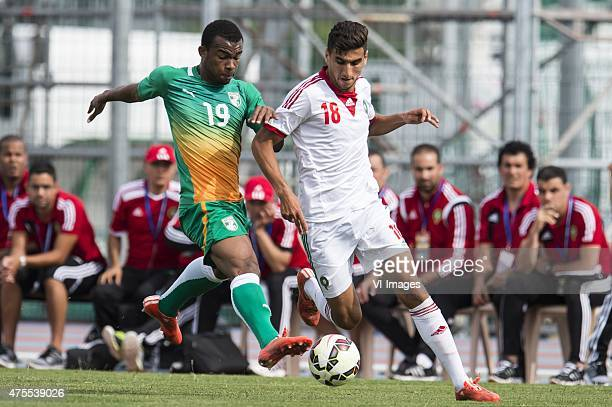 Digbo Habib Maiga of Cote d'Ivoire U21 Walid El Karti of Morocco U21 during the Festival International Espoirs de Football tournament match between...