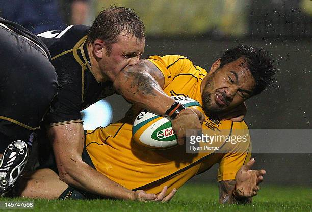 Digby Ioane of Australia is tackled by Alasdair Kellock of Scotland during the International Test match between the Australian Wallabies and Scotland...