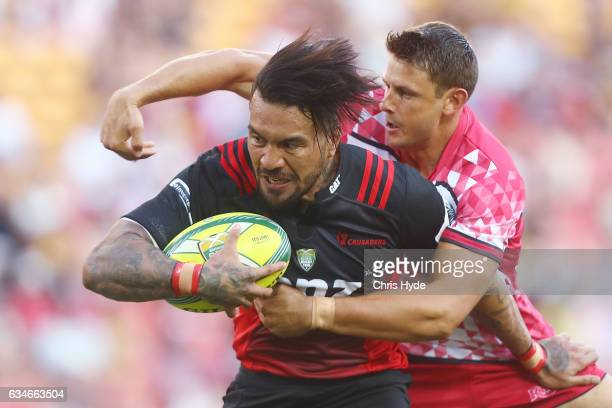 Digby Ioane of the Crusaders makes a break to score a try during the Rugby Global Tens match between Crusaders and Reds at Suncorp Stadium on...