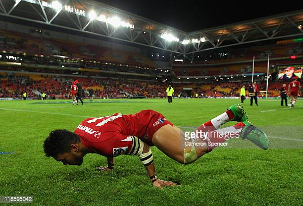 Digby Ioane of the Reds break-dances for the crowd after winning the 2011 Super Rugby Grand Final match between the Reds and the Crusaders at Suncorp...
