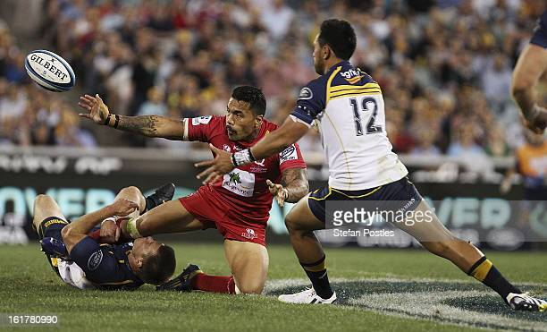 Digby Ioane of the Reds is tackled by Clyde Rathbone of the Brumbies during the round 1 Super Rugby match between the Brumbies and the Reds at...