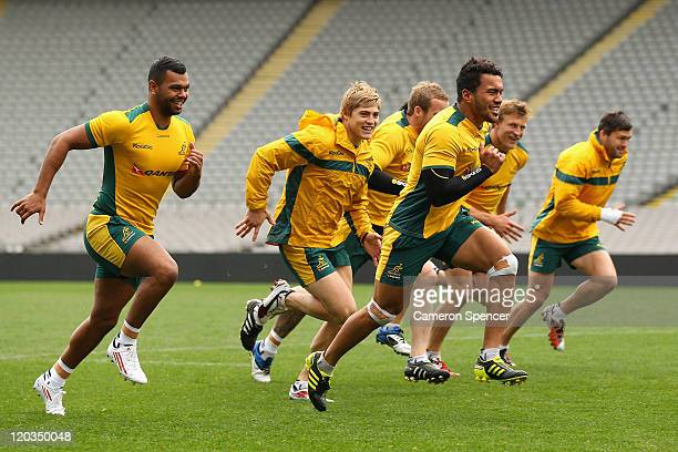 Digby Ioane of the Wallabies leads team mates in a sprint during an Australian Wallabies Captain's Run at Eden Park on August 5, 2011 in Auckland,...