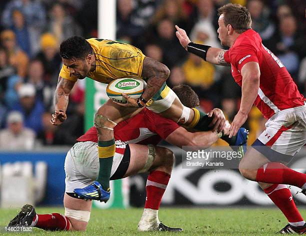 Digby Ioane of the Wallabies leaps into the Welsh defence during the international test match between the Australian Wallabies and Wales at Suncorp...