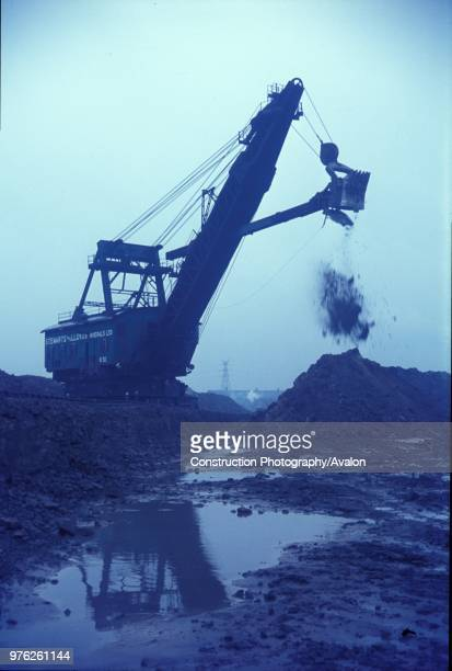 Digger at work on the mines which surrounded the vast Corby Steelworks situated on the Northamptonshire ironstone bed