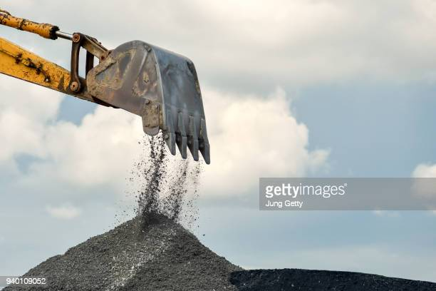 digger backhoe construction machine - bulldozer stock pictures, royalty-free photos & images