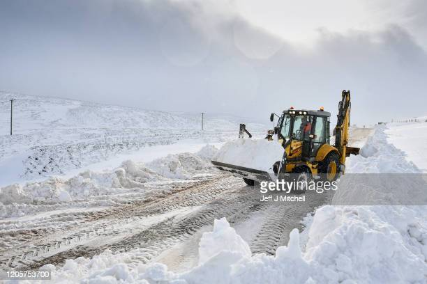 A digger clears drifting snow on the B797 on February 12 2020 on Wanlockhead Scotland A yellow warning for snow and ice remains in place across most...
