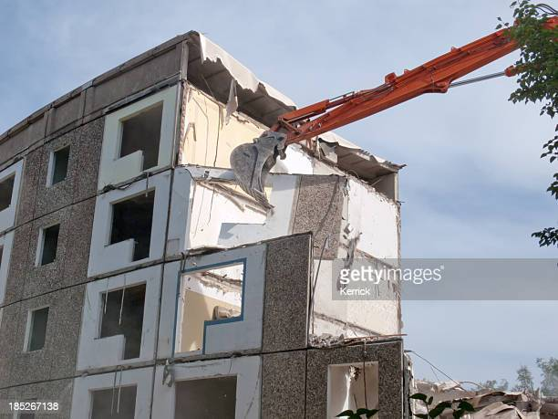 Digger demolishing a living house - GDR style