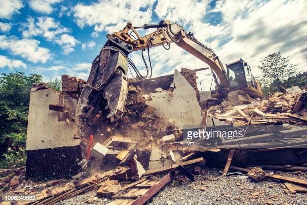 digger demolishing an old brick building - demolishing stock pictures, royalty-free photos & images
