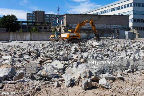 a digger demolishing houses for reconstruction - demolishing stock pictures, royalty-free photos & images