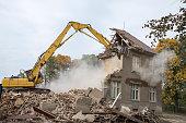 digger demolishing houses
