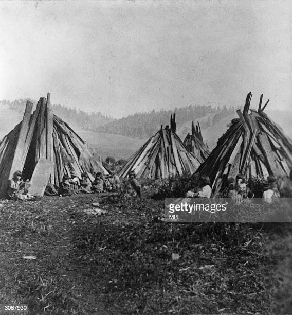 'Digger' Indians members of the southern branch of the Paiute tribe camped near Mendocino They live in wickiups huts of stick and brush fastened to...