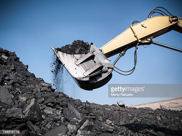 digger lifting coal from opencast coalmine - coal mining stock photos and pictures