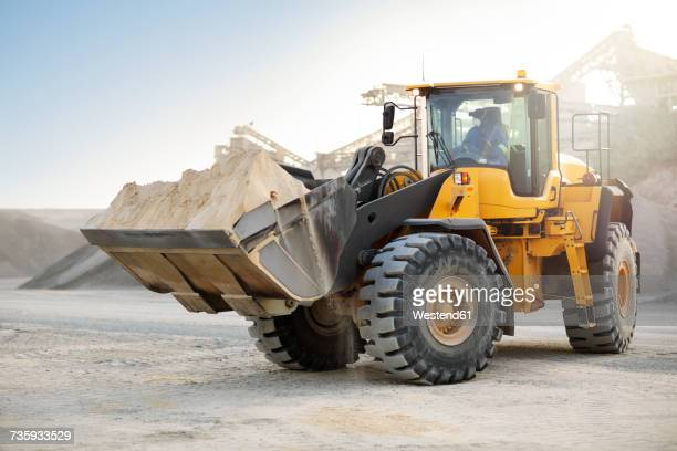 digger working at quarry - excavator stock photos and pictures
