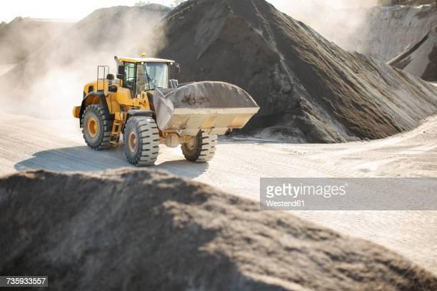 Digger working at quarry