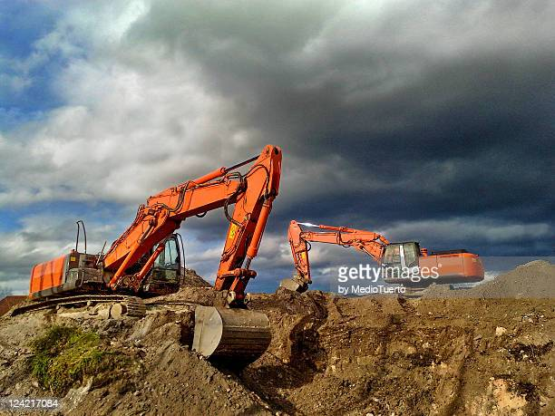 diggers at construction site - アラバ県 ストックフォトと画像