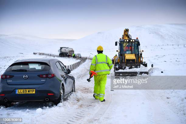 Diggers clear snow on the A702 Dalveen pass where on Tuesday evening Moffat mountain rescue team helped twelve people to safety on February 12 2020...