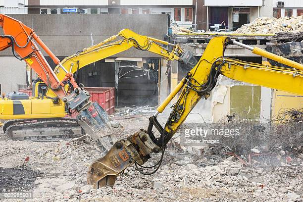 Diggers demolishing buildings