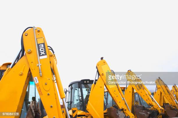 Diggers for sale on auction yard England UK