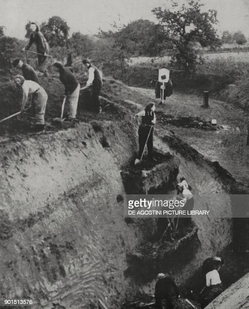 Digging a trench near Aachen Germany World War II photograph by Atlantic from L'Illustrazione Italiana Year LXXI No 48 November 26 1944
