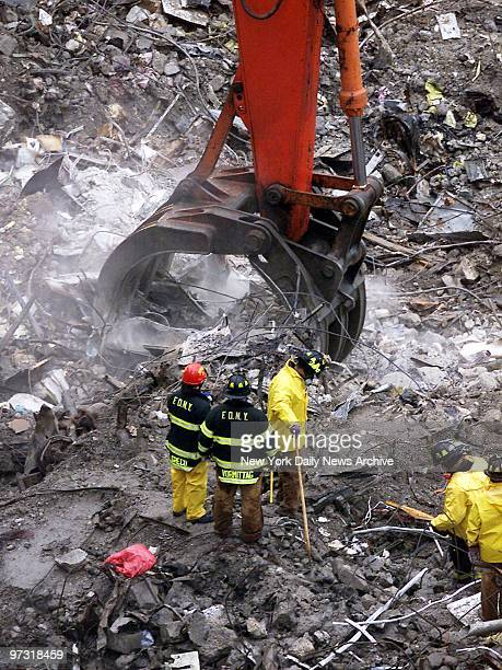 Digging carefully at the site of the collapsed lobby of the South Tower, workers continue to search for the bodies of victims of the attack on the...