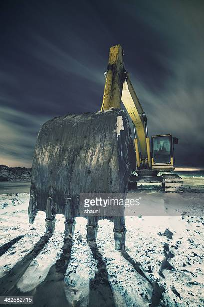 digging into the snow - excavator stock photos and pictures
