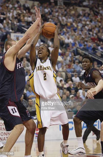 J Diggs of the California Golden Bears shoots over Jan Fikiel of the Pennsylvania Quakers during the first round of the 2002 NCAA Division I Men's...