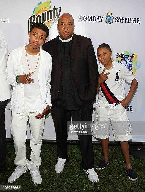 Diggy Simmons Rev Run and Russy Simmons attend the Art For Life East Hampton 11th Annual Benefit at Russell Simmons' East Hampton Estate on July 24...