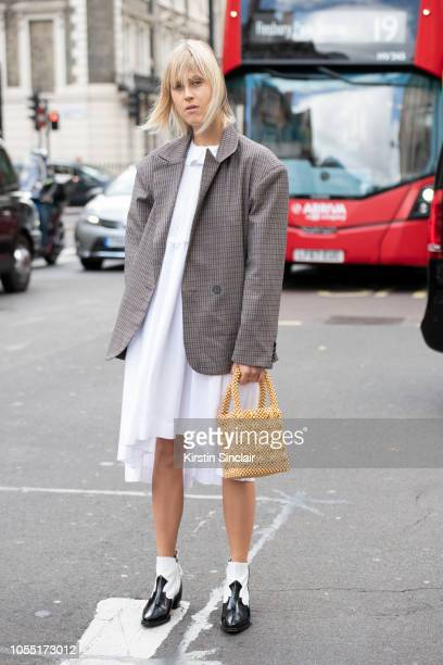 Digita Influencer Linda Tol wears a Frankie dress Alexa Chung jacket and boots and a Shrimps bag during London Fashion Week September 2018 on...
