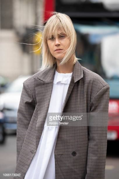 Digita Influencer Linda Tol wears a Frankie dress and an Alexa Chung jacket during London Fashion Week September 2018 on September 15 2018 in London...