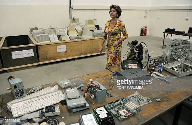 EU digital agenda commissioner Neelie Kroes visits on September 27 2011 a computer waste management center which is run by the charitable...