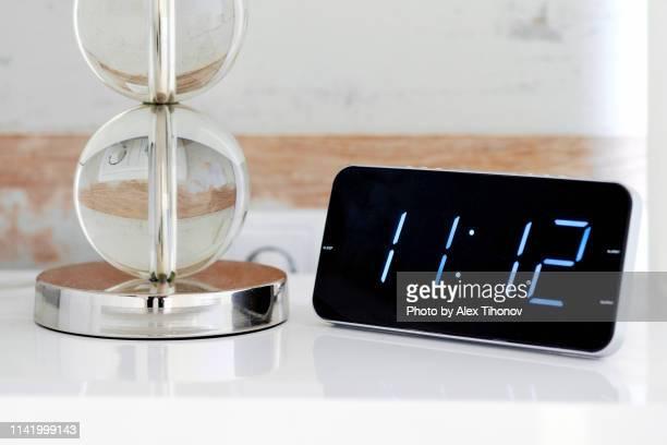 Digital alarm clock, blue digits over black background