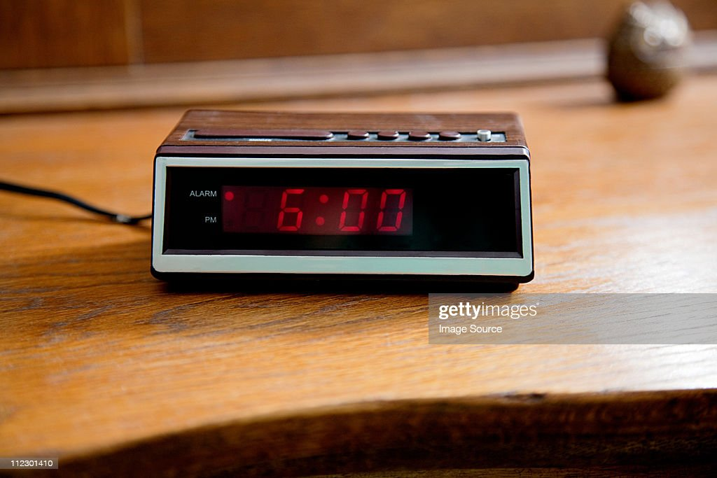 Digital alarm clock showing 6.00am : Stock Photo