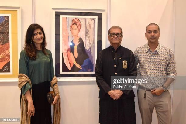 Digital artist Dilip De with his son Ranadip De and Radhi Jangla against De's 'Anuradha' at the Smartphone School Of Art Exhibit 'Celebration Of The...